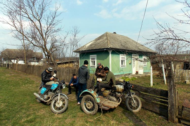 Members of a 'Challenge into Missions' (CiM) outreach team get in touch and share tracts with local young men during an outreach in a Moldovan village in spring 2016. The CiM mission training uses study weeks and practical outreaches to help young Moldova