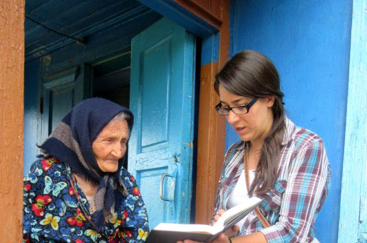 A Moldovan OM worker is sharing from the Bible during a visit to an elderly lady. Visiting poor families and neglected elderly is a vital part of OM's 'Love Moldova' outreaches, bringing food parcels to relieve the often desperate physical needs and God's