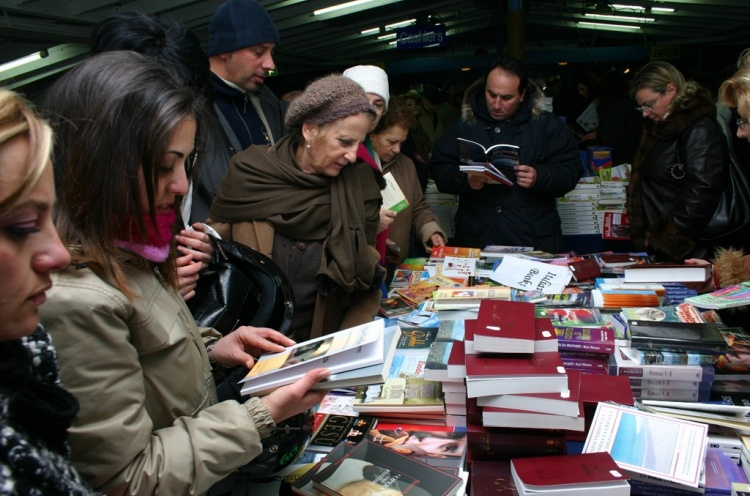 Local people looking through a book table. - Palermo, Italy - 16 Jan 2005 - Nathanael Mueller