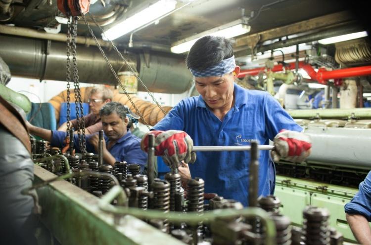 First Engineer Su Chol Kim (South Korea) works on generator 2. - San Fernando, Philippines - 30 May 2013 - Doseong Park