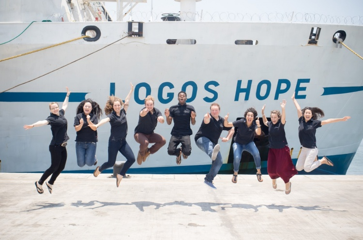 Logos Hope's international cafe team takes an exciting photo on the quayside in Tema, Ghana. - 04 Sep 2016 - Lincoln Bacchus