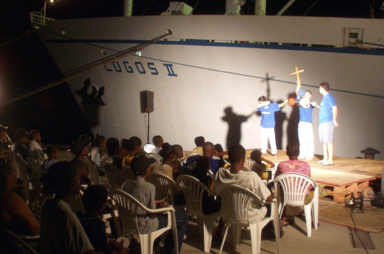 Crewmembers share their faith to crowds in front of the ship. - Kingston, St. Vincent - 06 Mar 2002 - Andrea Laurita