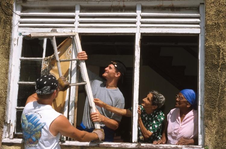Building team putting new windows into a home for elderly women. - Georgetown, Guyana - 15 Aug 2002 - Susanna Burton